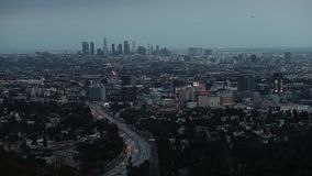 Los Angeles skyline city timelapse with zoom. Beautiful transition from dusk to night lights overlooking DTLA and. Los Angeles skyline city timelapse. Beautiful stock video
