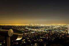Los Angeles skyline at night from Griffith Observatory. Los Angeles skyline at night with telescope Stock Photography