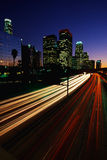 Los Angeles skyline with streaked freeway lights Royalty Free Stock Photos