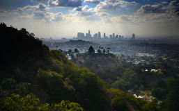 Los Angeles Skyline under Radiant Clouds Royalty Free Stock Images