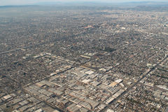 Los Angeles Suburbs Aerial Photo. An aerial photograph of the endless expanse of suburbs and buildings, seen in the flat lands of the city of Los Angeles, with Stock Photo