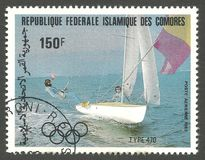 Los Angeles Summer Olympics, Boat class 470. Comoros - stamp printed 1983, Multicolor Air Mail Edition of offset printing with Topic Sport and Olympic Games Stock Image