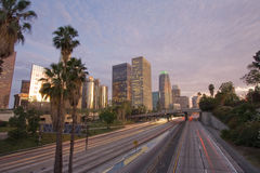 Los Angeles at sunset. Los Angeles city and highway at sunset Royalty Free Stock Photos