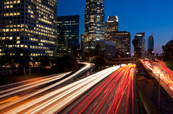 Los Angeles Urban Skyline. Los Angeles Skyline and Freeway at Sunset royalty free stock image
