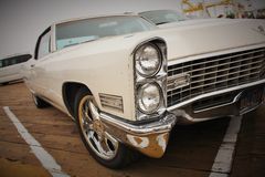Los Angeles, USA. Circa September 2010. An old vintage white cadillac. A picture of an old car in perspective and viewed from the front of the bumpers Royalty Free Stock Photos
