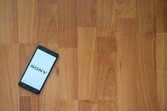 Sony on smartphone screen. Los Angeles, USA, july 18, 2017: Sony on smartphone screen placed on the laptop on wooden background Stock Photos