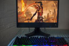 LOS ANGELES, USA - JUNE 11, 2019: game DOOM Eternal Illustrative editorial. LOS ANGELES, USA - JUNE 11, 2019: game DOOM Eternal on a computer monitor, a gamer royalty free stock images