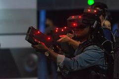 A woman plays a video game using virtual reality glasses Stock Photo