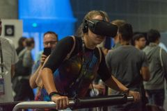 A woman plays a video game using virtual reality glasses Royalty Free Stock Photography