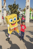 Los Angeles-USA, October, 3: Cartoon Character Sponge Bob Playin. G with Little Asian Boy at Universal Studios in Los Angeles, California in October, 3, 2013 Royalty Free Stock Photo