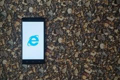 Internet explorer logo on smartphone on background of small stones. Los Angeles, USA, october 18, 2017: Internet explorer logo on smartphone on background of Stock Photo