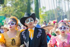 Sugar skull masked dressed as married couple during Day of the D Stock Photo