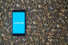 Twitter logo on smartphone on background of small stones. Los Angeles, USA, october 18, 2017: Twitter logo on smartphone on background of small stones Royalty Free Stock Photography
