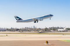 Los Angeles International Airport (LAX). LOS ANGELES, USA - SEP 26, 2015: Cathay Pacific Cargo takes off at the Los Angeles International Airport (LAX) , the Royalty Free Stock Photos