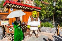 Universal Studios Hollywood Park, Los Angeles, USA. LOS ANGELES, USA - SEP 27, 2015: Fiona and Shrek in Shrek area in the Universal Studios Hollywood Park. Shrek Royalty Free Stock Photos