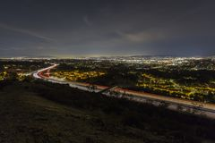 Los Angeles Valley Freeway Night. Night hilltop view of route 118 freeway entering the San Fernando Valley area in Los Angeles California Stock Photo