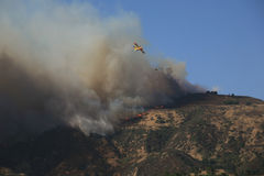 Los Angeles Wildfires. Planes flying over CA wildfire, October 13, 2008 to drop water and fight the rapidly spreading fire near Los Angeles Stock Images