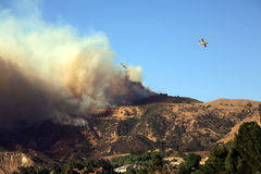 Los Angeles Wildfires. Planes flying over CA wildfire, October 13, 2008 to drop water and fight the rapidly spreading fire near Los Angeles Royalty Free Stock Images