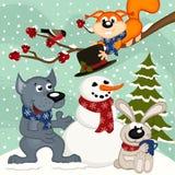 Los animales hacen el muñeco de nieve Fotografía de archivo libre de regalías