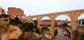 Los Arcos aqueduct in summer. Teruel Stock Image