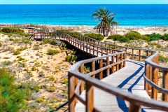 Los Arenales del Sol beach in Costa Blanca. Spain. Wooden boardwalk on the Los Arenales del Sol beach. Alicante province, Costa Blanca. Spain stock images