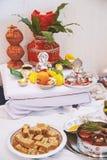 Los artículos de la adoración para el puja de la ceremonia del hilo, forcus del pooja en la estatua de Ganesha Imagen de archivo libre de regalías
