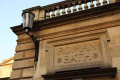 Los baños romanos firman adentro el baño Foto de archivo libre de regalías
