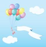 Los balones de aire vuelan con la bandera Imagenes de archivo
