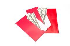 Los billetes de banco del dólar de EE. UU. en rojo se convierten Foto de archivo libre de regalías