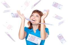 Los billetes de banco del euro 500 están cayendo en muchacha Foto de archivo libre de regalías