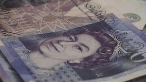 Los billetes de banco de la libra esterlina británica mienten en la tabla metrajes