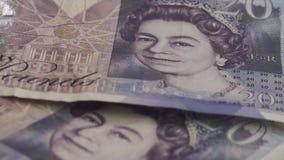 Los billetes de banco de la libra esterlina británica mienten en la tabla almacen de video