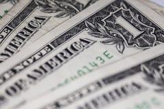 Los billetes de dólar uno les gusta un fondo Foto de archivo