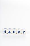 Los bloques deletrean la palabra feliz Foto de archivo libre de regalías