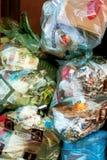 Los bolsos de basura se cierran para arriba fotografía de archivo libre de regalías