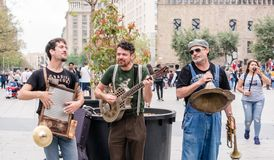 `Los Boozan Dukes` band playing on the street. In Barcelona near the Gothic Quarter on peculiar musical instruments royalty free stock photos