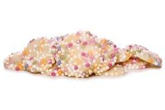 Los botones blancos del chocolate con asperjan el recorte Imagenes de archivo