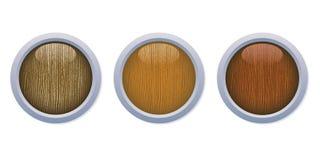 Los botones de madera brillantes medios con un metal suenan Fotos de archivo