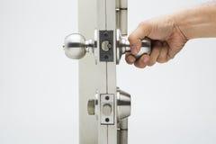 Los botones de puerta, fondo de aluminio del blanco de la puerta Fotografía de archivo