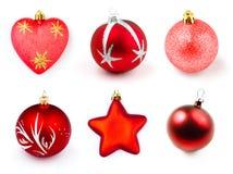 Los boubles o las bolas rojos de la Navidad aislaron la colección Imagenes de archivo