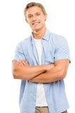 Los brazos felices del hombre joven doblaron aislado en el fondo blanco Imágenes de archivo libres de regalías