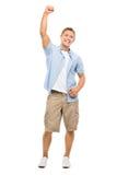 Los brazos felices del hombre joven doblaron aislado en el fondo blanco Foto de archivo libre de regalías