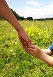 los brazos miman e hijo Fotografía de archivo