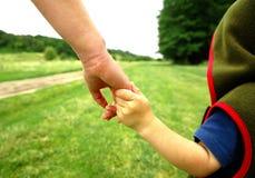 los brazos miman e hijo Imagenes de archivo