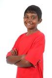 Los brazos sonrientes del adolescente plegable en estudio Imágenes de archivo libres de regalías