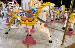 Los caballos de feliz van ronda Fotos de archivo