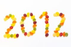 Los caramelos de goma coloridos arreglaron en dígitos Imágenes de archivo libres de regalías