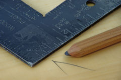 Los carpinteros que enmarcan el cuadrado Imagenes de archivo