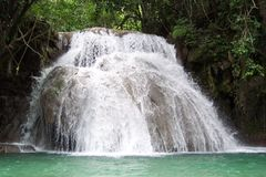 Los Cascadas. Photo of tropical waterfalls in the highlands of Huatulco Mexico.  This is near a coffee plantation.  A very popular swimming hole.  The water is Stock Photo