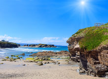 Los Castros sunshiny beach Galicia, Spain. House on cliff and summer Atlantic sunshiny sandy beach Los Castros Galicia, Spain Stock Image